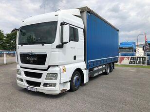 camion bâché MAN TGX 24.440 flatbed